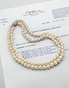 A two-strand natural pearl necklace, by Cartier.