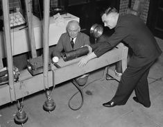 Using a newly designed apparatus, the U.S. Bureau of Standards workers are experimenting to determine the relative home-run qualities of American, National and International baseballs on February 21, 1938. American History, February, Amazing, Us History
