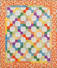 'Tie One On', bow-tie quilt by Anna Lena. It's hard to see the bows at first because your eye goes to the quite areas.
