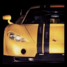 Yellow Ascari A10 with speed stripes