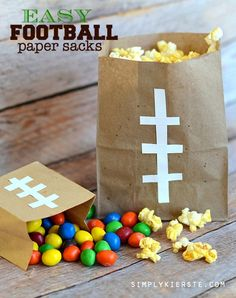If you're looking for a simple and cute way to serve popcorn for game day or a birthday party, these Football Paper Sacks are super easy and inexpensive!