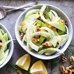 A crunchy gluten free and vegan Fennel and Apple Salad with walnuts and raisins.