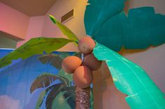 Paper palm trees and brown balloon coconuts for Shipwrecked VBS. Explore more decoration ideas at Concordia Supply!