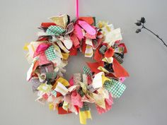 Another fantastic wreath.  No tutorial, but I assume you just tie pieces of fabric to a wire wreath base and you're done.  Seems easy enough.