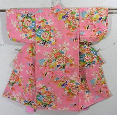 This is a charming girl's kimono with flower cart of 'Botan'(peony) and 'Kiku'(chrysanthemum) and folded crane pattern, which is dyed