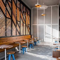 Timber slats creating a houndstooth pattern in this Dallas cafe with a hidden cocktail bar behind it ~ designed by Official 💭 photo by Robert Yu via Dezeen