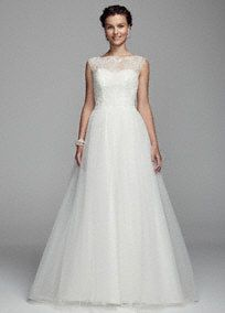 All eyes will be on you as you walk down the aisle in this stunning ball gown!  Cap sleeve tulle ball gown features ultra-feminine illusion neckline.  Bodice is adorned with beaded lace appliques.  Chapel train. Sizes 0-14.  Available in stores and online Ivory. White available for Special Order only.  Fully lined. Back zip. Imported. Dry clean only. Available in Plus sizes as Style 9WG3672. To preserve your wedding dreams, try our Wedding Gown Preservation Kit.