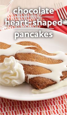 "What says ""I love you"" for Valentine's Day breakfast better than Chocolate Heart-Shaped Pancakes? This hot-cocoa pancake recipe is drizzled with a gooey marshmallow sauce and topped with Reddi-wip for a special sweetheart treat. What a great V-Day brunch idea!"