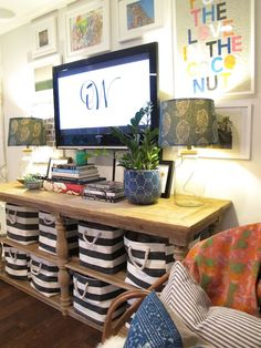 Amber Designs - living rooms - The Container Store Rugby Stripe Bin, gallery wall, art gallery walls, framed art gallery wall, gallery wall ...