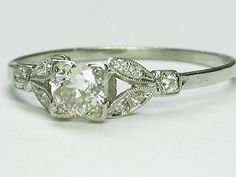 vintage wedding ring. Like the band setting but not the square diamond. Still pretty though!