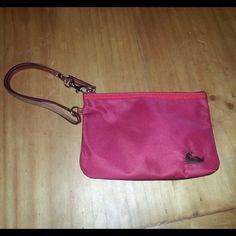 """♦️DOONEY & BOURKE♦️ Red/Navy Blue Nylon Wristlet 100% Authentic: DOONEY & BOURKE Red/Navy Blue Nylon Wristlet RED front, NAVY back, FUCHSIA interior. Brown leather hand strap and zipper pull, gold-tone hardware, dogleash clip. 7 by 5 inches, with approx. 10 inch strap (when unclipped) and about 4"""" when clipped. GENTLY USED AND IN MINT CONDITION. See pictures. No rips or tears! NO DUSTBAG. Message me with ANY questions. NO TRADES BUNDLE  PRICE IS FIRM Dooney & Bourke Bags Clutches & Wristlets"""