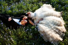 Bride and Groom lay in the bluebonnets after their wedding at the Retreat at Balcones Springs near Austin, Texas