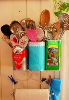 The idea of repurposing cans to hold items around your house isn't exactly a new one, but this method of hanging them is. Although there are IKEA wall mount systems that mimic this, I love the simplicity of repurposed objects and the art that their packaging brings to your kitchen. (Plus you'll finally be able to pull out that whisk without your spatula and wooden spoon tumbling to the floor.)