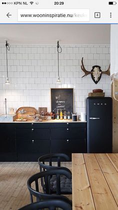 77 Gorgeous Examples of Scandinavian Interior Design Scandinavian-kitchen-with-d. 77 Gorgeous Examples of Scandinavian Interior Design Scandinavian-kitchen-with-dark-features New Kitchen, Kitchen Interior, Kitchen Dining, Kitchen Decor, Kitchen Ideas, Kitchen Wood, Kitchen Cabinets, Decorating Kitchen, Kitchen Furniture