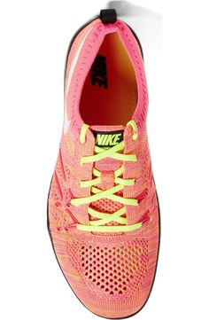 Obsessing over these pink Nike training shoes with vibrant lime green details.