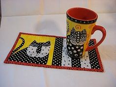 Cherry blossoms- quilting studio: Mug Rug,  I like how they have copied the mug in the design, very cute!