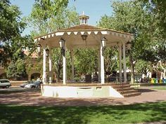"""The magical town of Arcada isn't based on any specific place, but more of a concept: that small town somewhere in the USA. Everything is normal, friendly and a bit more peaceful. Thus, the town is nicknamed, """"Normalville, USA."""" I visualize a town square with a band stand, clock tower, grass and flowers. In the winter, its decorated with fairy lights and frosted with snow.    http://www.virtualalbuquerque.com/VirtualABQ/OldTownPlaza/OldTownPlaza1.jpg"""