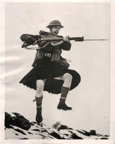 1941- Kilted member of the Queen's Own Cameron Cameron Highlanders caught mid-air during practice bayonet charge.