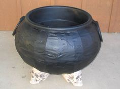 Make a cauldron from a bucket, duct tape, & cardboard. Ingenious!