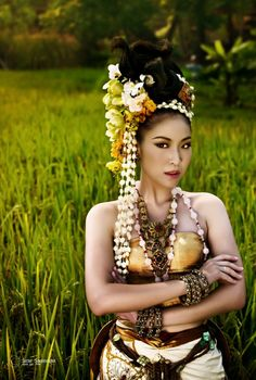 Thai women and Thai Traditional dress .  Thai (Siamese) Synthetic Silk and Gold Metal Accessories with long garland.