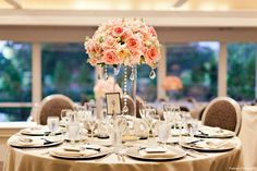 Wedding decorations for the wedding reception - Pretty coral and peach roses!