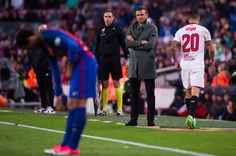 Victor Machin 'Vitolo' (R) of Sevilla FC walks by Head coach Luis Enrique Martinez of FC Barcelona after being shown a red card during the La Liga match between FC Barcelona and Sevilla FC at Camp Nou stadium on April 5, 2017 in Barcelona, Catalonia.