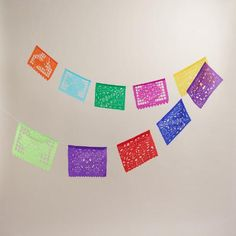 Decorate your home for Dia de los Muertos with our traditional paper banner, handcut by artisans in Mexico. It boasts orange, green, purple, pink, and yellow colors, as well as traditional icons including flowers, skulls, horses and La Catrina.  Please add in that this is handcut by artisans in Mexico.