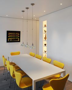 contemporary dining room with clean white dining table yellow dining chairs dark toned wood floors modern pendant lamps modern wall art of Give the Neutral & Natural Touch Just by Involving Wooden Furniture Around the House
