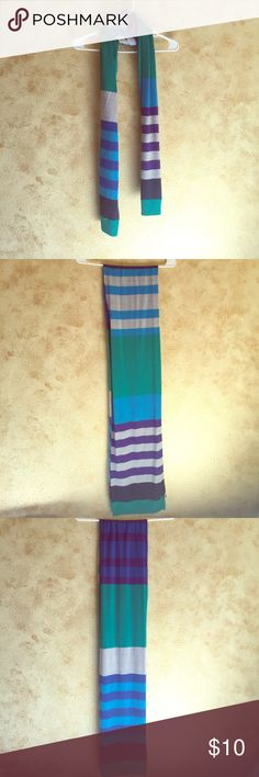 Multi Striped Scarf 100% Acrylic. Colors as you can see are purple, gray, blue and green. Lightly used in good condition with a little lint that can be picked off. Super cute wrapped around the neck like shown on the hanger. Available as a free item. All listings $10 and under are avail as free items. Ask me 🙂 Aeropostale Accessories Scarves & Wraps
