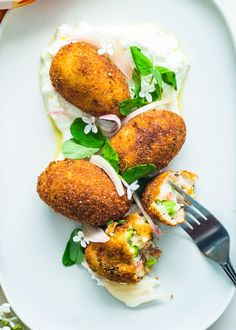 Kick off any celebration with these adorable Sweet Pea Chorizo Croquettes. Paired with a lemon ricotta sauce and pickled shallots, these crispy bites are hard to resist. Pickled Shallots, Gluten Free Puff Pastry, Chorizo, Fritters, Clean Eating Snacks, Salmon Burgers, Finger Foods, Appetizers, Side Dishes