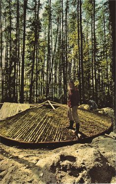 """Helped by Native Americans, Wendell Beckwith builds a ""snail home"" of logs; the moss-chinked roof will sprout an early vegetable garden warmed from within."" - National Geographic, 1978"