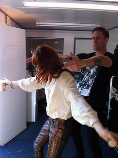 Florence Welch shields Rob Ackroyd with her body whilst he points finger pistols randomly at everybody.