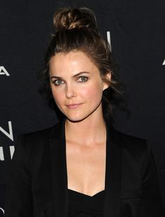 Felicity who? Keri Russell wrapped her curls up into a cute topknot, leaving those crucial by-the-ear tendrils loose.   - Cosmopolitan.com