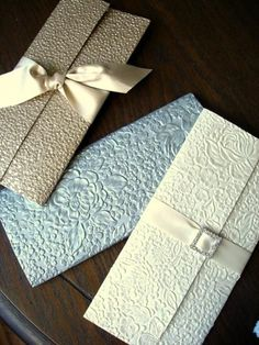 wedding invitation elegant high end embossed silver unique beautiful handmade