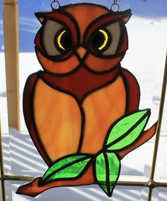Stained glass owl on a branch suncatcher wall by ManemannArt