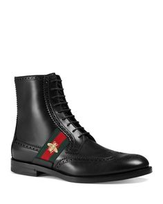 A intriguing bend of military heritage and classic detailing makes these boots from Gucci a must for daring downtown looks. | Leather | Made in Italy | Smooth leather upper | Wingtip with broguing |