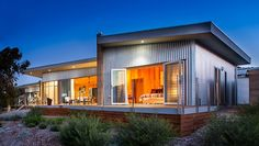 Turning heads on the Oyster Walk, this country coastal shack utilises thermal mass through rammed earth and polished concrete floors, but is crafted to sit lightly within the landscape. Thoughtful architectural detailing is complemented by the client's selection of finishes and artistic touches, like the delightful pelican gate.