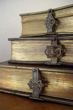 love these old and worn metal clasps on these old books....