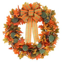 A ring of bright fall foliage, natural grape vines, and green lotus pods, this autumn wreath greets guests with warm harvest hues.  Produ...