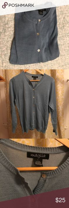 Grey Blue Magnolia Sweater with Iridescent Buttons This is a size Large long-sleeve button up sweater. It is 71% silk and 29% viscose. Hand wash or machine wash on delicate with cold water. The 8 buttons are my favorite- they look almost like mother of pearl, it's a very light, soft sweater. Magnolia Sweaters Cardigans