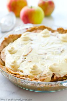 Homemade snickerdoodle cookie crust is filled with sweet apple pie filling and then topped with plenty of cream cheese frosting to create the ultimate snickerdoodle apple cheesecake pie! @WholeHeavenly: