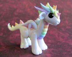 Pastel Rainbow Dragon by DragonsAndBeasties on deviantART