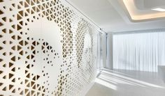 Wall panelling made of solid surface material HI-MACS® with portraits.