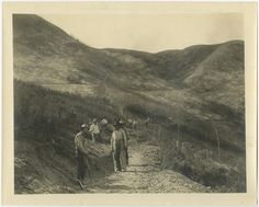 "Workmen with shovels and pickaxes at Hogback, California, 1908. Caption on reverse reads ""Constructing road Hogs Back near Le Bron.""  Catherine Mulholland Collection. San Fernando Valley History Digital Library."