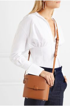 Tan leather (Calf) Snap-fastening front flap Weighs approximately 1.3lbs/ 0.6kg Made in Italy