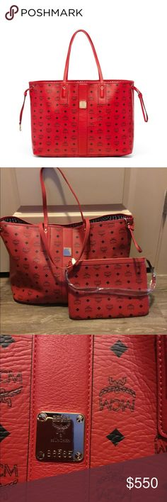 """MCM Liz Large red reversible tote bag nwot MCM Liz Large reversible ruby red tote bag 100% authentic. wristlet included nwot tiny blemish on the strap on the reversible side see pic.dust bag/ box not included 🚨please no trades🚨17""""x13""""x8"""" measures extra large MCM Bags Totes"""