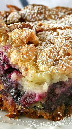 Ooey Gooey Lemon Blueberry Cake ~ full of blueberries with a zesty lemon cream cheese topping.