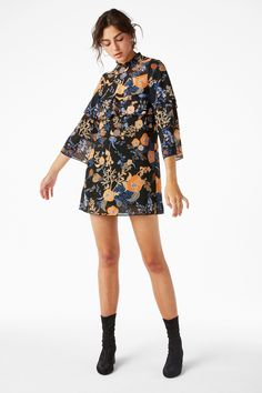 "This super-autumnal <a href=""https://www.monki.com/en_gbp/clothing/dresses/product.ruffled-trumpet-sleeved-dress-black-magic/pattern-perfection.0547507002.html"" target=""_blank"" data-skimlinks-tracking='4676420'>ruffle dress</a>."