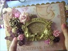 Paper Line - DCWV Once Upon A Time  Chipboard-  7 1/2 X 9 Scallop Chipboard by Melissa Frances www.scrapbook.com    Front cover WOC Flowers  Stickles in gold on all flowers   -  Pale Pink Curly Wild Roses FM-00392   - White Trellis Roses painted in mettalic gold FM-00485  - Brown town floral foundations 20mm EX-00040  -25 mm Plum/ Aubergine open...