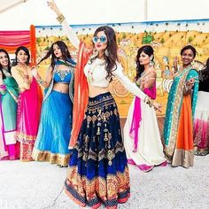 Enjoy your wedding day with your BFFs.We love the fun shot of bride with her bridesmaids. Big Indian Wedding, Indian Wedding Photos, Indian Bridal, Korean Wedding, Mehendi Outfits, Bridal Outfits, Indian Outfits, Indian Wedding Photography, Wedding Photography Poses
